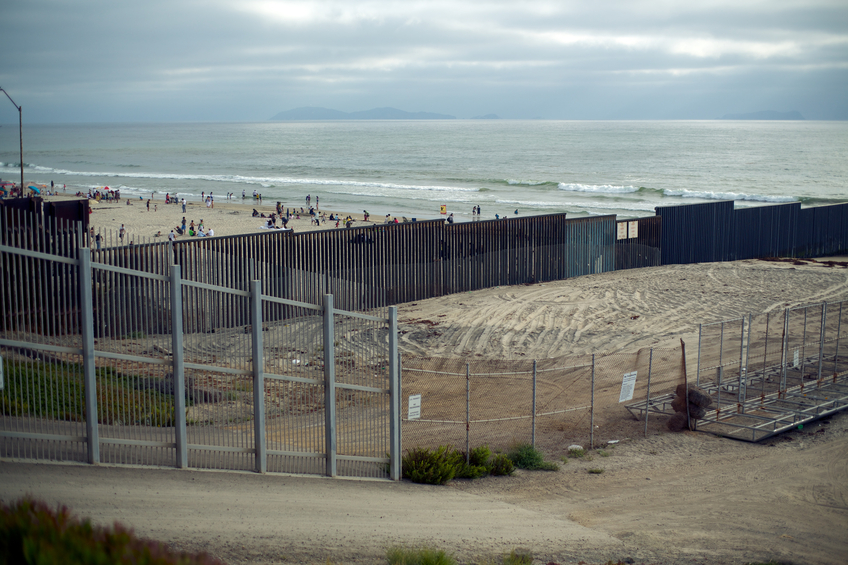 the US / Mexican border fence. picture taken on the US side in San Diego. the other side is Tijuna / Mexico. August 2013.